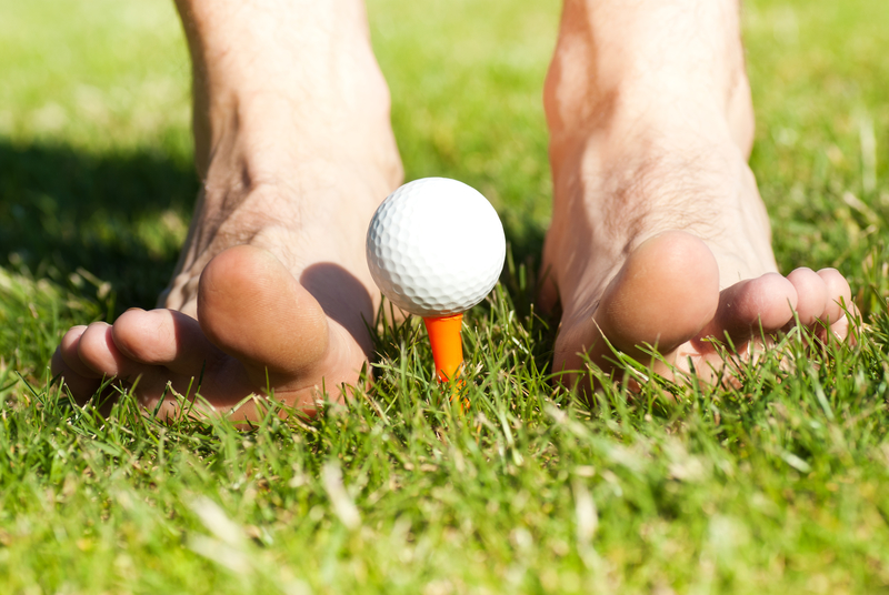 feet and golf ball