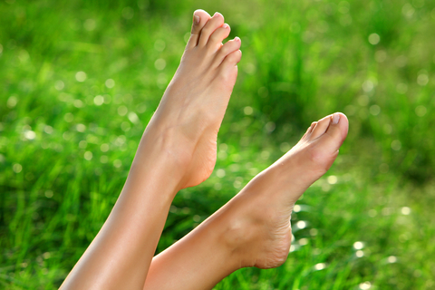 feet and green grass