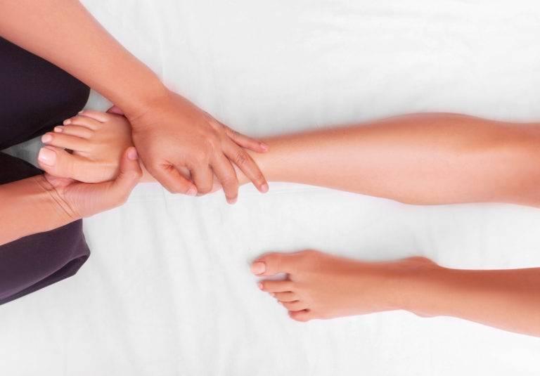 reflexology foot massage, spa foot treatment by wood stick,Thailand
